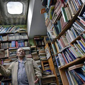 Bookshelves piled on top of bookshelves